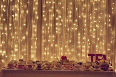 Christmas lights behind sheer curtains to give the room a ro... / wedding ideas - Juxtapost