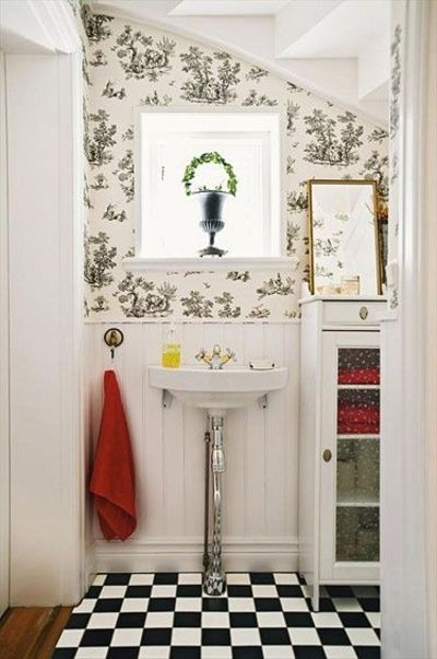 Checker Board floor. Small bathroom. Wallpaper. Wainscoting. Interesting pedestal sink. #