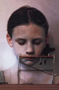 Gottfried Helnwein working on large painting.