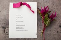 Beautiful DIY ceremony program with ribbon in wedding colors + raw edge paper. Shot by Christina Diane