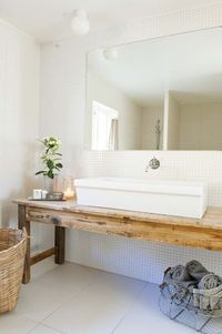modern bath with antique table vanity