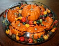 Decorate with a bowl of small pumpkins.
