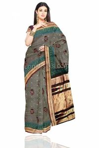 This new trendy designer sari has been introduced to retain the expectations of traditional printed sari. This is a marvelous saree with Uppada tie and dye beige accent grey color saree. This sari has got beautiful all over marooned brown color block pr...