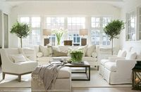 simple neutral living room w lots of natural greenery