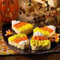 Decorate Rice Krispies Treats to look like giant candy corn for a fun #Halloween treat.