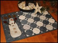 Snowball Candle Mat by Primitive Gatherings... these would be darling placemats, using the Snowman fabrics by Kris Lammers of Maywood Studios!