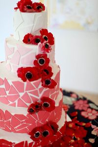 Pink and red tile and poppy cake