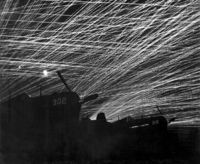 Yontan airfield AA against Japanese night raiders on Ryukyu Islands Okinawa in Japan; F4Us Hell's Belles squadron in fore. (photo by T. Chorlest, 1945)