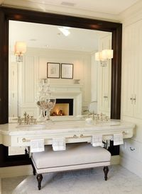 Double sink, and a fire-place, in a bathroom ...