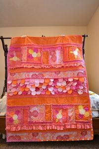 This is one of my favorite rag quilts that I have done so far. It combines many of my favorite sewing techniques...Ruffles, Scallops, and Applique....