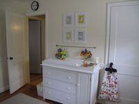 along for the ride: Our House [Nursery] - bar with toys next to changing table