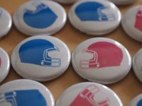 30 pack Gender Reveal Party Favors Sports Football Themed Baby Shower Pinback Buttons. $11.99, via Etsy.