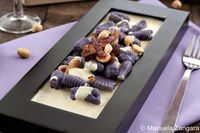 Purple Gnocchi On A Parmigiano Reggiano Fondue, Toasted Hazelnuts and Crunchy Speck