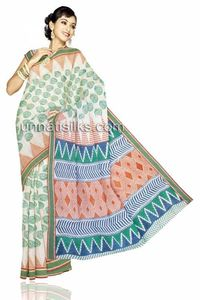 Feel on top of the world with this exquisite white madurai cotton saree. It has detailed printed designs combined with lots of love and care. This madurai cotton saree is embellished with attractive all over green color mango booties and 2 inch green za...