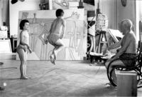 Pablo Picasso plays jump rope in his studio with his children, Paloma and Claude. Photo by David Douglas Duncan.