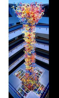 """The Children's Museum of Indianapolis is unveiling a 9-ton glass sculpture by artist Dale Chihuly today. At 43 feet tall, """"Fireworks of Glass,"""" is the largest permanent blown glass piece that the famed glass artist has ever done. It is made up..."""