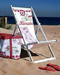 Camp chairs with sling seats are ideal for lounging by the sea, especially when they have been updated with beach-worthy prints.
