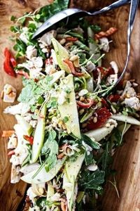 warm chicken salad with peppers, pear, and toasted pine nuts
