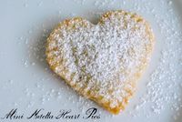 Mini Nutella Heart Pies with Powdered Sugar