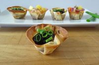 BBQ Pork Wonton's - A little wonton wrapper filled with shredded barbecue pork and topped with your favorite toppings.