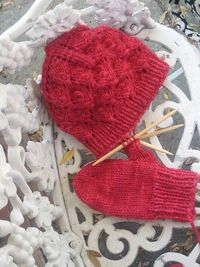 Lace hat with matching mittens.
