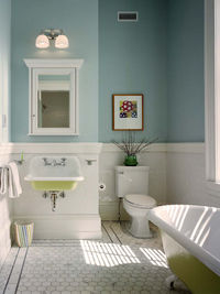 I love the pop of citrus on the tub and sink Hanson Contractor Group