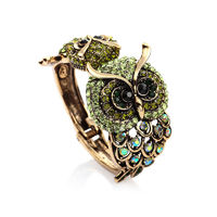 This vintage bangle cuff bracelet features mother and baby double owl design paved with twinkling rhinestones.Hinged design on the linked point made the Rhinestone Vintage Double Gold Owl Bracelet Bangle Cuff easy to wear on and take off.
