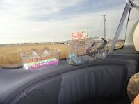 Use shower baskets to stick to the window on road trips to hold markers and other trinkets! Why didn't I think of this?